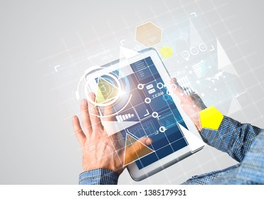 Digital world concept graphic on tablet screen in male hands