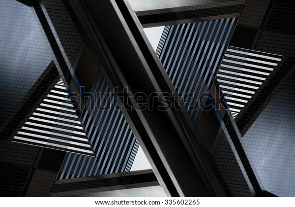 Digitally altered close-up photograph of abstract architecture fragment. Distinctive contemporary composition with geometric structure in black and blue colors of twilight.