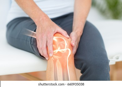 Digitally composite image of man suffering with knee cramp