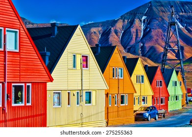 Digitally enhanced row of very colorful homes in Longyearbyen, Svalsbard, Norway.