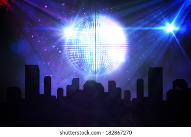 Digitally generated disco ball background with cityscape