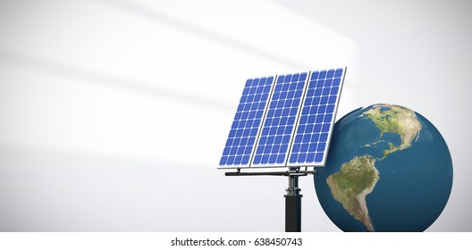 Digitally generated image of 3d globe and solar panel against light shade