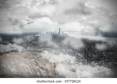 Digitally generated large rock overlooking foggy city