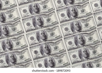 Digitally generated sheet of hundred dollar bills