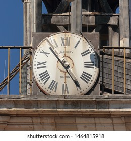 DIJON / FRANCE - AUGUST 17th, 2017: Clock of the town library (former Collège des Godrans). Black fingers and numbers on white clock face. Inscription: HAUBRY DIJON. Time on clock: 04h54