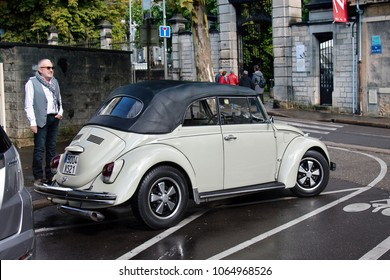 Dijon, France - September 16, 2017: VW, VeeDub, Volkswagen Super Beetle Classic with convertible top, Made in Germany, vintage car presented by host as fashionable car. Beatles old car
