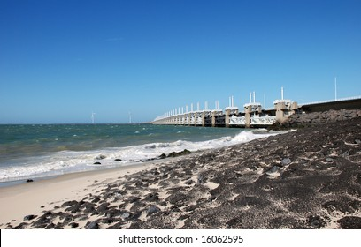 Dike beach and oosterschelde flood barrier