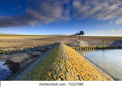 Dike in Holland at the sea