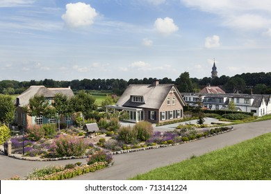 Dike and houses in Schoonhoven along the river Lek in the Netherlands
