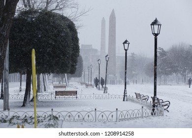 Dikilitas in Snow, Obelisk in ancient Hippodrome near Sultanahmet,Blue Mosque in Istanbul, Turkey
