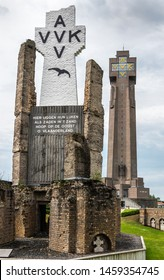 Diksmuide, Flanders, Belgium -  June 19, 2019: Black on White Crypt memorial, remnants of dynamited tower, and new IJzertoren, tallest peace monument of WW 1 against gray cloudscape.