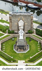 Diksmuide, Flanders, Belgium -  June 19, 2019: View on White Crypt memorial, remnants of dynamited tower, from up IJzertoren, tallest peace monument of WW 1. River and boats.