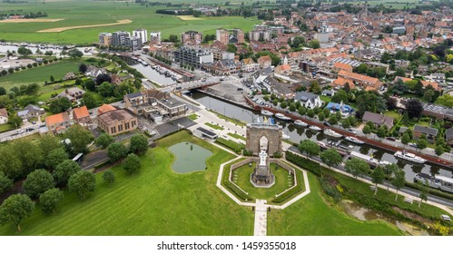 Diksmuide, Flanders, Belgium -  June 19, 2019: View on White Crypt memorial, remnants of dynamited tower, and city from up IJzertoren, tallest peace monument of WW 1.