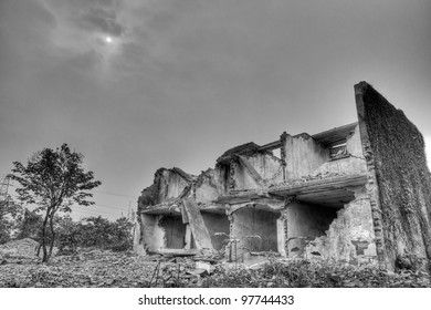 A dilapidated demolished housing under the sun