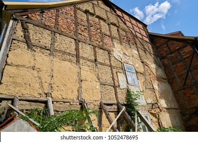 dilapidated facade of an old half-timbered house in the old town of Quedlinburg
