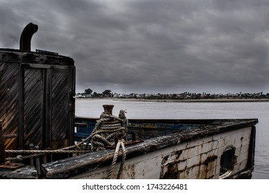 Dilapidated fishing boat docked at a harbour.