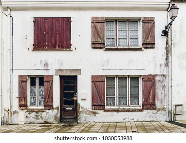 Dilapidated house facade in Brittany, France