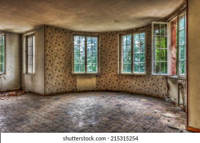 Dilapidated living room in an abandoned house, HDR