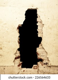 Dilapidated wall with black hole that can be removed.