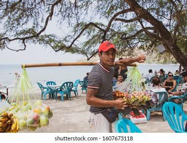 Dili  (East Timor) - November 28th  2019: Street vendor selling fresh fruit on the beach