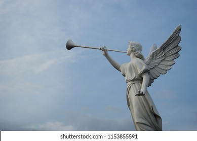 Dili Timor Leste on February 03, 2010: the angel statue was blowing trumpet