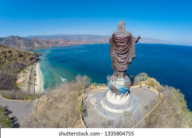 Dili, Timor-Leste - Aug 13, 2015: Aerial view of Cristo Rei of Dili, high statue of Jesus Christ located atop a globe in Dili city, East Timor, on a summit, overlooking the capital of Timor-Leste.