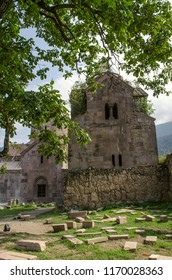 Dilijan, Armenia, August 24, 2018: The courtyard of the monastery Goshavank with a view of the medieval school and the book depository and the restored two tier belfry