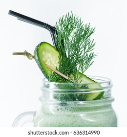 Dill and cucumber in a cocktail, green smoothies in a jar