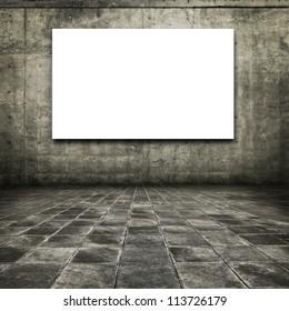 Dim concrete room with white screen board.