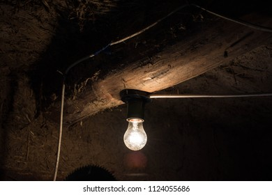 Dim Light Bulb In The Old Roomв