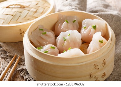 Dim Sum in bamboo steamer, Chinese cuisine. Closeup rustic style. horizontal
