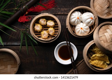 Dim Sum Dumplings on wooden table, Chinese traditional food. Chinese concept. Top view.