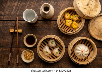 Dim sum, Dim Sum on the wooden table, top view and space for text input , Dim Sum (Chinese food) in steamed bamboo