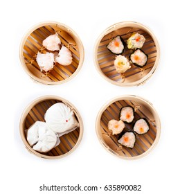 Dim sum and steamed buns in bamboo steamer on white background, Chinese food
