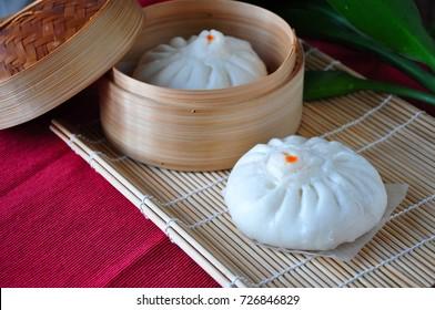 Dim sum steamed pork bun put on bamboo mat