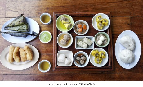 Dim sum /?dim?s?m is a style of Chinese cuisine prepared as small bite-sized portions of food served in small steamer baskets or on small plates