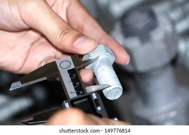 Dimension Check bolt by vernier