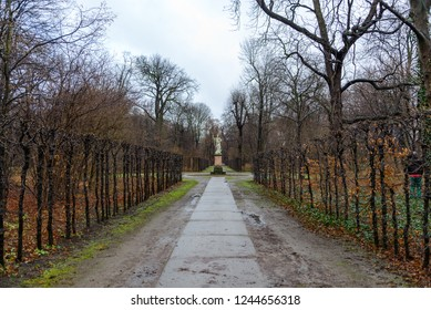 Diminish perspective outdoor scenery view of walkway and range of tree with damp after raining atmosphere in Schlossgarten at Schloss Charlottenburg, Berlin, Germany.