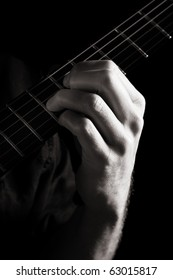 Diminished seventh chord (A-dim7) on electric guitar; toned monochrome image