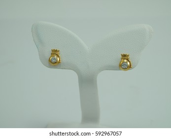 dimond earring gold with money bag