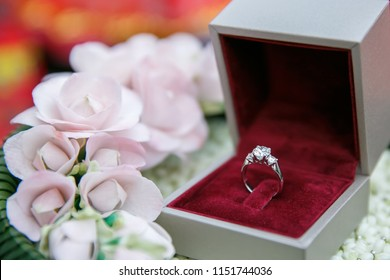 Dimond wedding ring in box with flower decoration