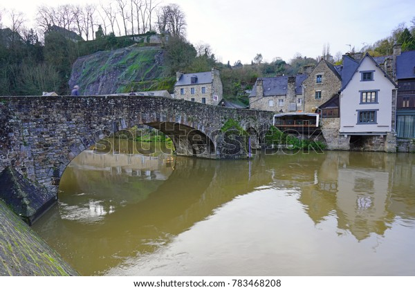 DINAN, FRANCE -28 DEC 2017- View of Port Dinan, the picturesque harbor of the medieval town of Dinan on the River Rancein the Cotes d'Armor, Brittany, France.