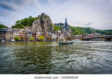 DINANT, BELGIUM – JUNE 16, 2014: The Collegiate Church of Notre-Dame is the most important landmark of Dinant, located in the Waloon region, Belgium