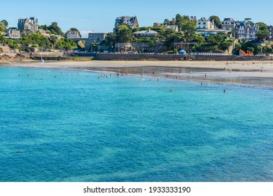 Dinard, Brittany, France - August 31, 2016: View of the Plage de l'Écluse, the main fine sand beach of this popular French seaside resort, at low tide from a coastal path with spectacular views.