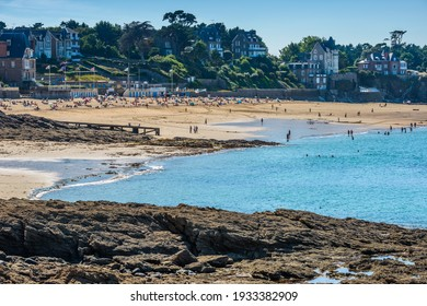 Dinard, Brittany, France - August 31, 2016: View of the Plage de l'Écluse, the main fine sand beach of this prestigious French seaside resort, at low tide from a coastal path with spectacular views.