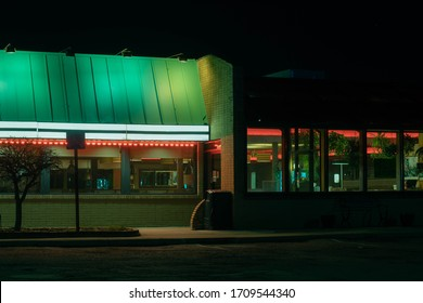 a diner late at night, long after close, empty and lonely.