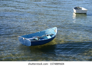 Dinghies floating on clear water