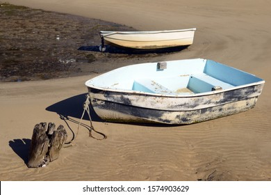 Dinghies resting on sand at low tide Australia