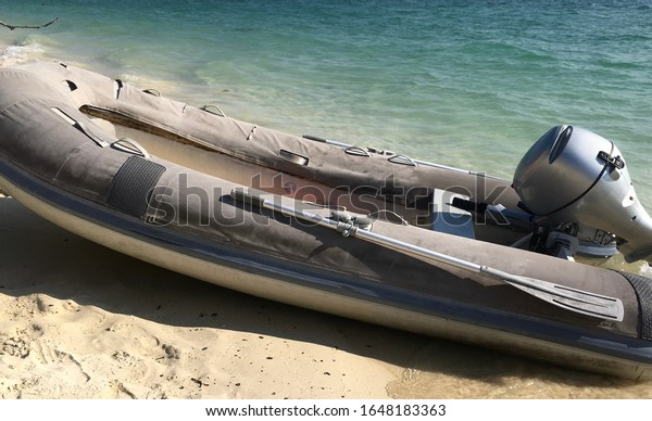 A dinghy boat parked on the beach.