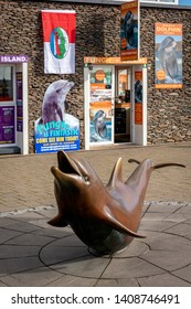 Dingle, County Kerry, Ireland. 22 October 2018. Fungi the dolphin statue in front of tourist office in the town centre. The dolphin could be seen swimming in the small coastal village's bay.